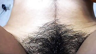 Lusty hairy cunt masturbate for the camera